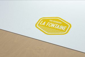 logo la fontaine jaune moutarde